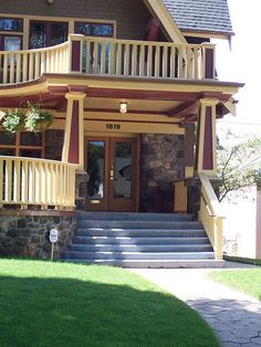 Stone porch tied in with upstairs balcony