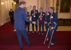 Prince Harry Photos Photos - Prince Harry speaks with Ladies Hockey Team with Susannah Townsend on crutches at a reception for Team GB's 2016 Olympic and Paralympic teams at Buckingham Palace October 18, 2016 in London, England. - Olympics