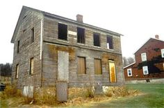 A color photograph of a faded two story wood house. Windows are missing and boards replace several of the openings. One house that did not survive well when the miners moved away. Moving Away, Coal Mining, Second Story, House Windows, House In The Woods, When Us, Sisters, Survival, Photograph