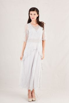 This vintage flutter dress will bring you right into spring. The Nataya Mother's Essence Dress is a tea-length ivory and silver gown. Now an amazing 20% OFF