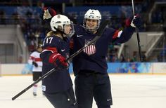 USA forward Monique Lamoureux-Morando (7) celebrates with forward Jocelyne Lamoureux-Davidson (17) after scoring a goal against Switzerland in a women's preliminary round game during the 2014 Sochi Olympics.(Photo: Winslow Townson, USA TODAY Sports)      Members of the U.S....  http://usa.swengen.com/u-s-women-agree-to-new-deal-with-usa-hockey-will-play-at-world-championships/