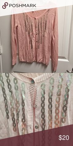 Sweater with sequin design Light pink/peach cardigan sweater with button up front and sequin design. Size medium, runs small. True color is more like the first image. Sweaters Cardigans