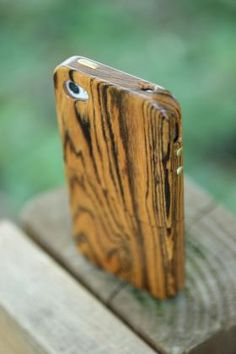 Cool site that sells wooden iPhone cases: carved.com