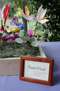 so freaking cute! faux flower escort cards - definitely goes with botanical theme