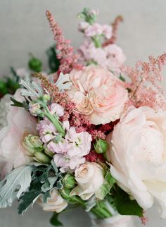 Astilbe, rose and greenery wedding bouquet: http://www.stylemepretty.com/2017/02/22/a-parisian-dream-wedding-that-all-starts-with-a-couture-gown/ Photography: Greg Finck - http://www.gregfinck.com/ Assistant Photography: Marie Film - http://www.marie-filmphotographer.com/ and Oliver Fly - http://oliverfly.com/