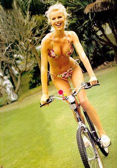 Eva Herzigova. Supermodel on her bike.