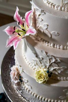 Buttercream wedding cake // sugar flowers// stargazer lily// roses// Cindy's Cakery// Paul Harrison Photography