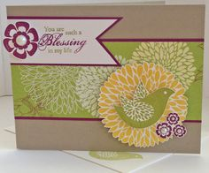 lessings From Heaven & Betsys Blossoms stamp sets; Crumb Cake, Whisper White & Rich Razzleberry CS; Floral District DSP; Lucky Limeade, Rich Razzleberry & Daffodil Delight inks; self-adhesive Rhinestones.