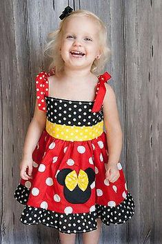 Red and white polka dot jumper with yellow trim.