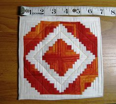 "This mini log cabin quilt is less than 7"" square. Oh my!"