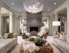 Contemporary Living Room with Oregon tile and marble silver polished travertine slab, Chandelier, Columns, Crown molding