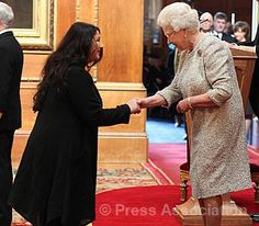 Singer Kate Bush receives her CBE for services to Music from The Queen during an Investiture ceremony at Windsor Castle, 10 April 2013.  © Press Association Photo by The British Monarchy
