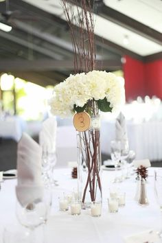 Birch hydrangea centerpieces with wood slice table numbers