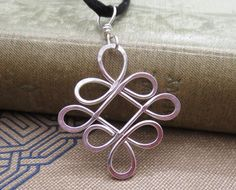 New in the shop! Looping Celtic Crossed Knots Sterling Silver by nicholasandfelice, $18.00