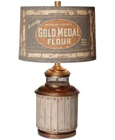 Inspired by rustic artifacts, Pacific Coast's handmade Americana table lamp adds a touch of eclectic style to your space. Perfect for country and contemporary decor, a printed canvas shade featuring v