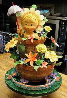Step-By-Step 3D Cake Sculpting (Baby in a Flower Pot) By Anonymous on CakeCentral.com