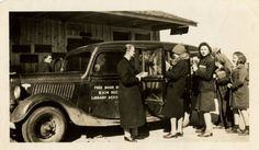 Beaufort Hyde Martin Regional Library Association bookmobile with librarians and patrons, February 1942  ^cs
