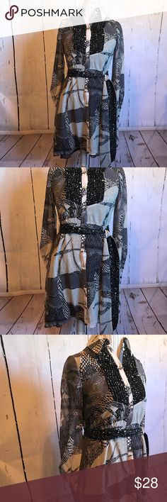 Long sleeved dress Belted dress with silver buttons and patterns of grey, silver, and black. Kirna Zabete Dresses