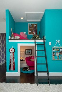 What a fun children's loft! The bottom hosts a cozy reading nook to hang out for some quiet time, or for chatting with the girls. The turquoise walls are