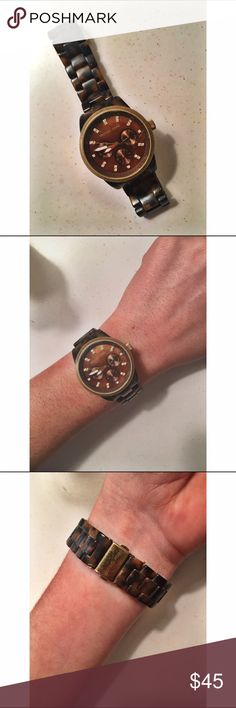 Michael Kors Tortoiseshell Watch Real Michael Kors women's clasp tortoiseshell watch. There are some scratches on the face  however I have not spent any money to fix it (that's why the price is so low) and believe it could be improved with very low maintenance. Michael Kors Accessories Watches