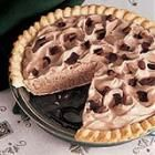 Frozen Chocolate Pie Recipe  1 (3 ounce) package cream cheese, softened  1/2 cup sugar  1 teaspoon vanilla extract  1/3 cup baking cocoa  1/3 cup milk  1 (8 ounce) carton frozen whipped topping, thawed  1 (9 inch) baked pie shell  Chocolate curls or chips (optional)