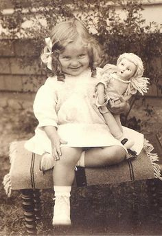 Love this picture of the little girl and her doll