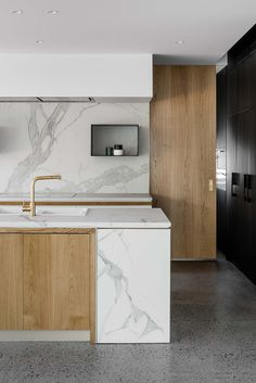 "Engaged to design the interiors for a new residential home by CLP Architecture, Taylor Pressly Architects drew on a play of form, texture and contrast to create an elegant and luxurious family home in which both interior design and architecture resonate in harmony. The sculptural staircase, its sleek, white plaster-finished spiral reminiscent of the iconic Guggenheim Museum, ""was an integral part of the house design by CLP Architecture,"" says Taylor Pressly."