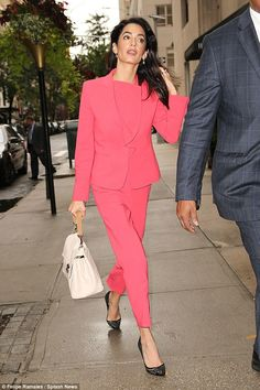 Pretty pink: Amal combined glamour and sophistication with aplomb as she arrived back at her Upper East Side hotel in New York on Thursday