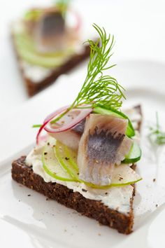 Rye Toasts with Herring, Apple, Cream Cheese & Cucumber. To fulfill your wishes, eat herring. The Dutch eat it raw, the Danes eat it boiled, the Polish like it pickled, and the Japanese eat the roe. Make a wish as you swallow.