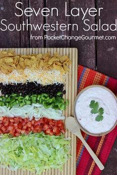 Perfect for Potluck, Picnic, Fourth of July or everyday meal, this Seven Layer Southwestern Salad goes together in a snap! Recipe on PocketChangeGourmet.com