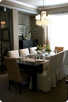 dining room ideas...black table with light chairs