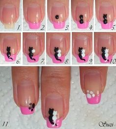 Hot pink nail tips with black and white kittens sitting on the pink.