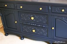 Navy painted buffet as a the nursery dresser and changing table for a little boy