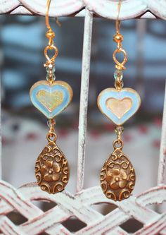 A personal favorite from my Etsy shop https://www.etsy.com/listing/230791753/picasso-aqua-and-gold-heart-bronze