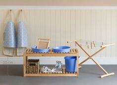 OUTDOOR WASHING:Aprons on pegs, Washing table with washboard,pitcher,basins and bucket, clothes drying rack and pins.