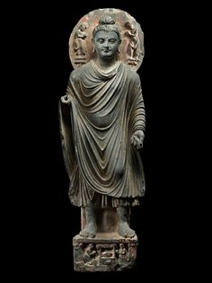 Buddha Sakyamuni. Pakistan, Gandhara, 2nd/3rd century. Schist. Height: 33 inches (83.8 cm).