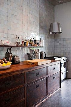 Unique kitchen with wall of tile