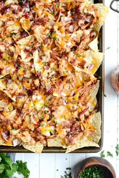 Sheet Pan BBQ Chicken Nachos are unbelievably delicious! Chips topped shredded chicken, cheddar and Monterrey Jack cheese, red onion and bacon! Bbq Nachos, Baked Nachos, Chicken Nachos Recipe, Nachos Loaded, Pulled Pork Nachos, Shredded Bbq Chicken, Barbecue Chicken, Barbecue Sauce, Sides For Bbq Chicken