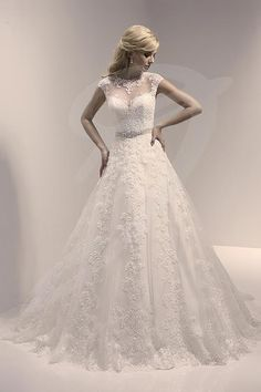 Balletts Bridal - 22340 - Wedding Gown by Jacquelin Bridals Canada - Sheer Illusion Neckline trimmed with Lace. Slight Cap Sleeve trimmed in lace. Self tie belt at waist. Aline Skirt