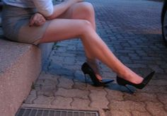 Show legs with black high heels