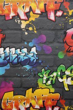 A fabulous multicoloured graffiti design on a black brick background.