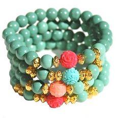 Beaded bohemian bracelet stack designed by Denise Yezbak Moore