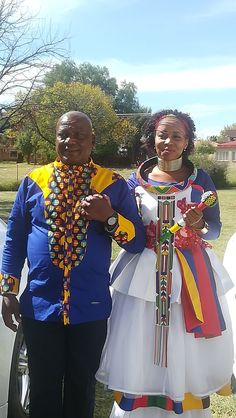 The father of the bride wearing his own traditional print shirt while his daughter the bride rocks her wedding Ndebele attire not forgetting the bead adornments that make the outfit what it is. Isn't she stunning? African Print Clothing, African Print Dresses, African Dress, African Prints, African Wedding Attire, African Attire, African Fashion Ankara, African Print Fashion, Father Of The Bride Outfit