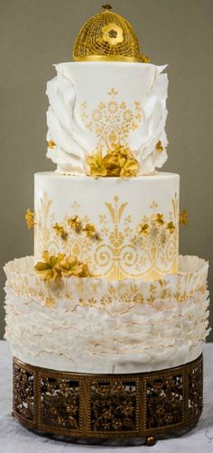 Princess Wedding Cake - Every element of the design was created from scratch at the atelier, including the crown that was piped with royal icing.