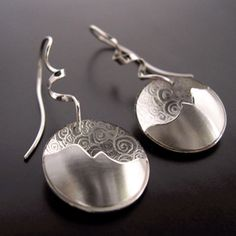 Sterling silver is cupped and textured on the inside with a swirl design. Sterling earwires are curled for additional fun.