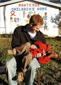 Prince Harry pictured with Mutsu Potsane at age six while on a visit to Lesotho 11 years ago. The boy struck up a lasting bond with Harry and the pair were reunited yesterday