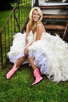 This is what a country princess wears to her wedding: pink cowgirl boots, a sparkly tiara and a feathery wedding dress.