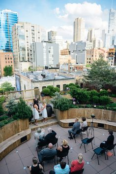 Lindsey & Leah say I do on our showroom rooftop.