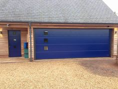 Garage doors with a personal touch Custom made garage doors: side hinged, sectional, sliding. Entrance Doors, Garage Doors, Front Entrances, Facade House, Home Photo, Sliding Doors, Touch, Building, Outdoor Decor