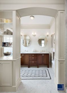 You can also plan a powder-room-size tile design in the middle of a larger room. In this photo the Ann Sacks tile installation is a throw rug look-alike in a bath with otherwise uniform lines and colors.